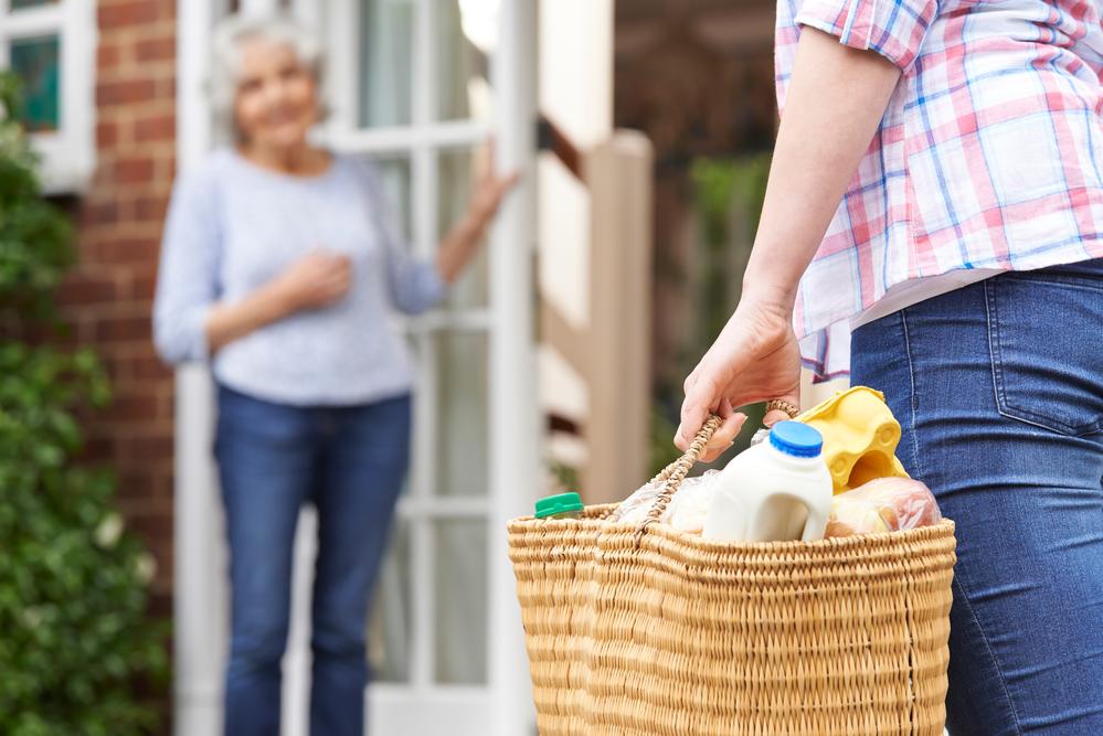 Person Doing Shopping For Elderly Neighbour